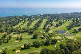 Aerial view of a golf course along the shores of Lake Michigan in the suburb of Glencoe, IL.