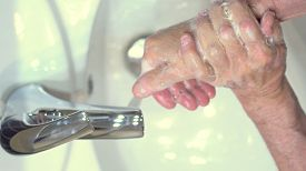 The Concept Of Protecting The Body From Germs And Viruses. Close Up Hands Of Senior Man That Applyin