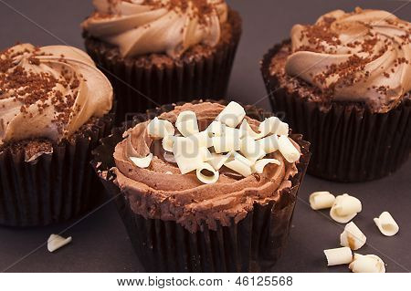 Delicious Chocolate Cupcakes With White Chocolate Curls