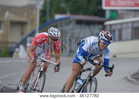 KIEV, UKRAINE - MAY 24: Reinis Andrijanovs, Latvia, left, and Vladislav Bakumenko, Ukraine, in the bicycle racing Race Horizon Park in Kiev, Ukraine on May 24, 2013