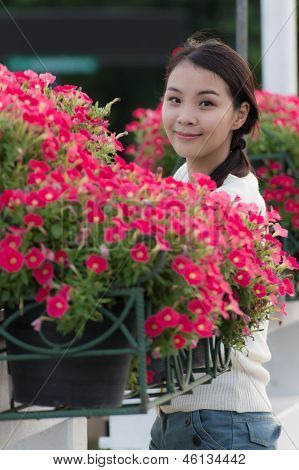 Thai Girl With Petunia Flowers