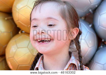 The Little Girl On The Background Of Soccer Balls.
