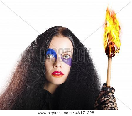 Staring Woman Holding Flame Torch