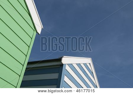 Green And Blue Beach Huts In Suffolk Uk