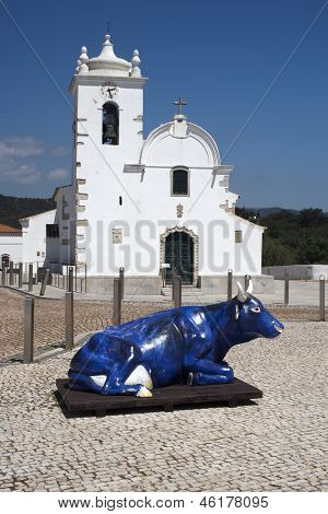 Church And Blue Cow At Querenca, Portugal