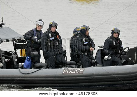 Police boats watching on Thames river