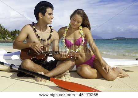 Couple On Beach With Ukulele