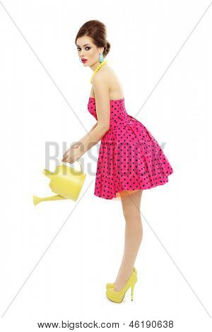 Young beautiful slim sexy girl with watering pot in her hands, over white background