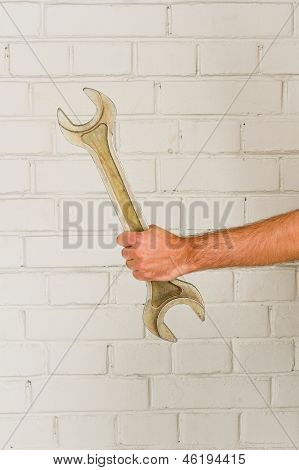 Man's Hand With Big Spanner