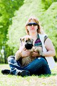 Irish soft coated wheaten terrier and woman poster