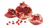 Pomegranate in a section on white background poster