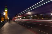 light trails on london bridge made from a london bus lights poster