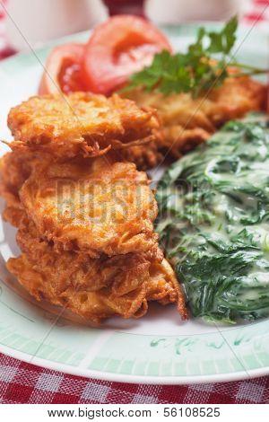 Latke, potato pancakes with creamy spinach mash