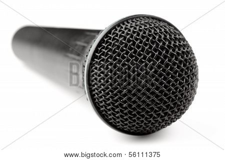 A Black Microphone Isolated On A White Background
