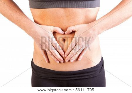 A woman's belly with heart shaped hands
