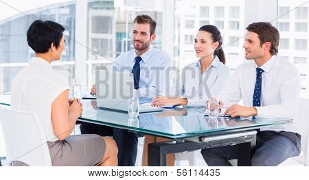 Recruiters checking the candidate during a job interview at office poster