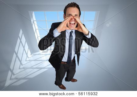 Shouting businessman against room with large windows