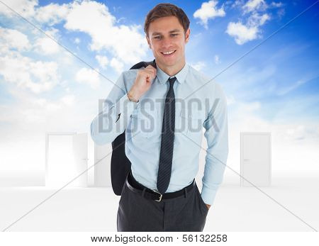Smiling businessman holding his jacket against opening door in sky