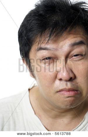 Miserable asian man portrait