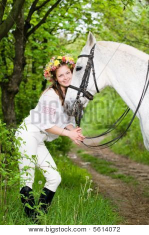 Laughing girl in floral wreath with horse poster