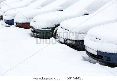 Cars on city street after large snowfall