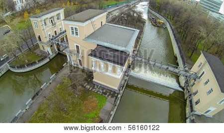 Ship on Yauza river with two sluices of Syromyatnicheskiy waterworks, view from unmanned quadrocopter.