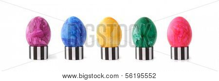 A line of colored Easter Egss. All isolated on white background.