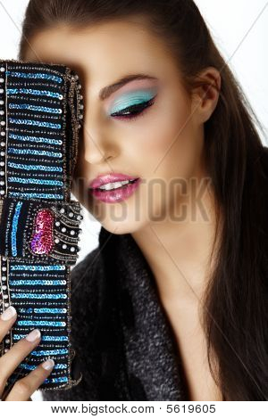Woman With Cat Eye Make-up And Bag.