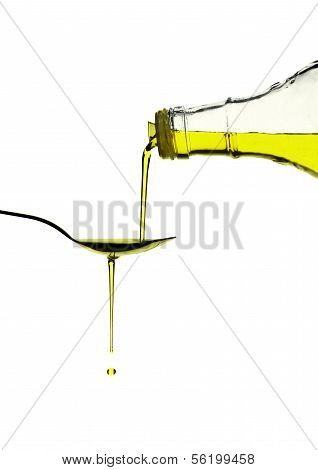 Olive Oil Pouring Over A Spoon