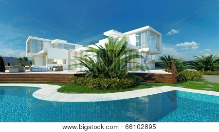 Exterior view of an angular glass walled modern upmarket tropical villa with white walls overlooking a landscaped blue swimming with pool with palm trees on a hot sunny day