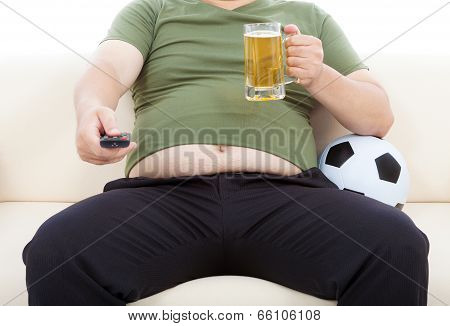Fat Man Drinking Beer  And Sitting On Sofa To Watch Tv