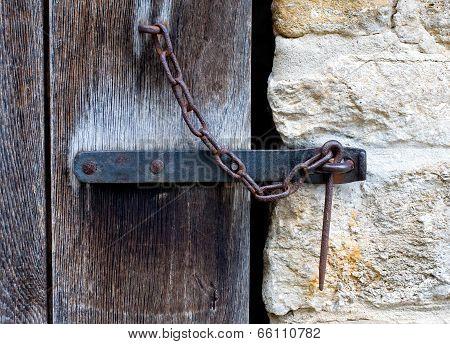 Iron Latch On Wooden Door