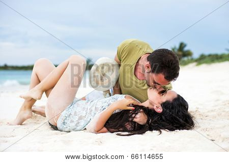 Young couple sharing a romantic moment in a tropical beach
