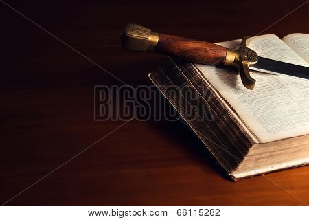 Old Open Bible With Sword