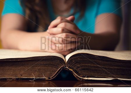 Open Bible With Praying Girl