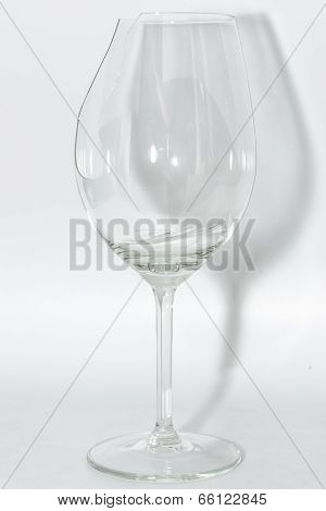 Broken Clear Wineglass With Sharp Glass Fragments Inside