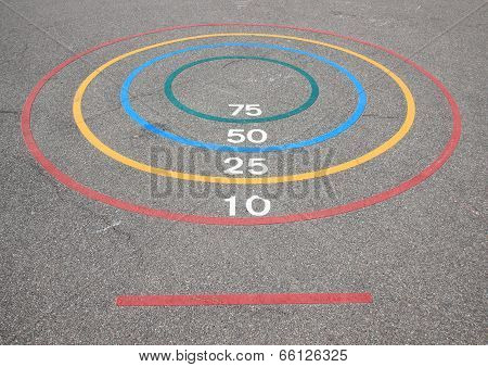 Quoits game with winning circles and baseline on asphalt poster