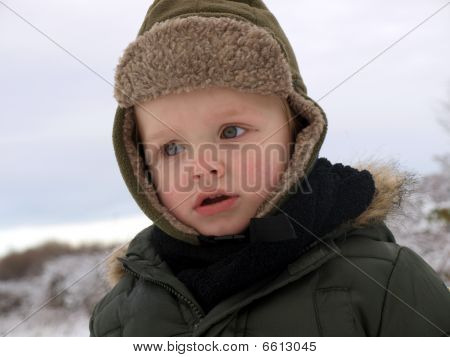 little boy in the winter day