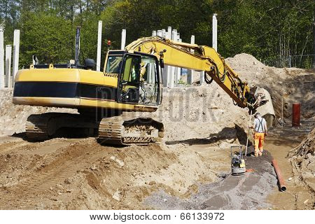 bulldozer, digger and site worker in action, road-works industry and constructions