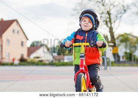 Little Toddler Boy Having Fun And Riding His Bike