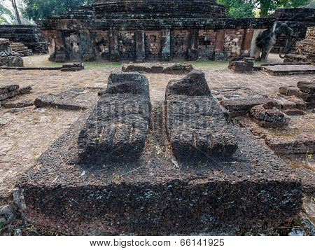 Foots Of Broken Ancient Buddha At Kamphaengphet Historical Park, Thailand