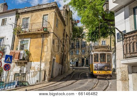 LISBON, PORTUGAL-MAY 25, 2014: Very touristic place in the old part of Lisbon, with a traditional tram passing by in the city of Lisbon, Portugal.