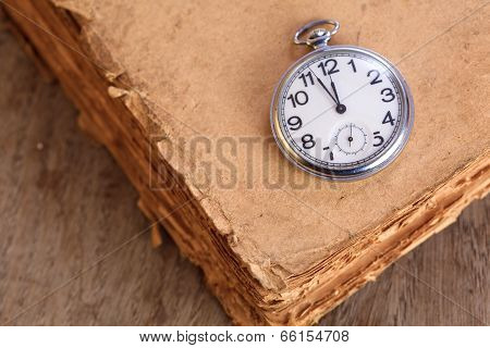 Pocket Watch On A Book
