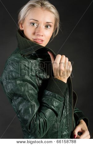 Portrait of a blonde in a green jacket