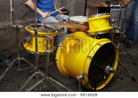 drummer is playing in studio. drumkit