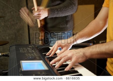 keyboard player playing in studio. player in out of focus