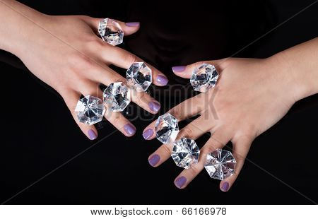 Close-up Of Woman's Hand And Diamonds
