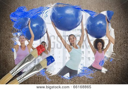 Composite image of fitness class at the gym against weathered surface with paintbrushes poster