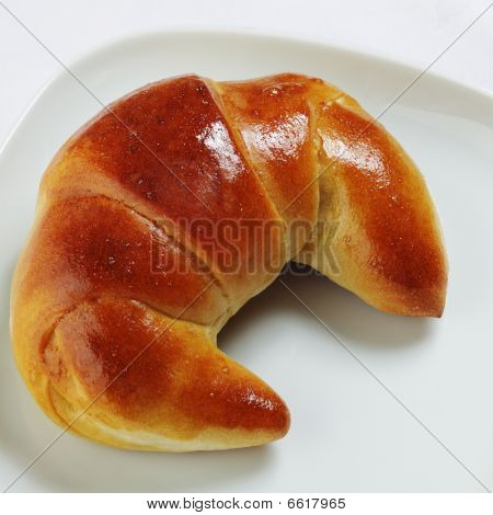 croissant on white plate