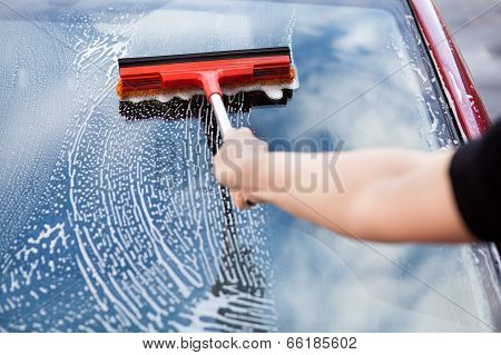 Close-up Of Hand Washing Car Window With Mop poster